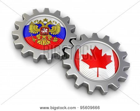 Russian and Canadian flags on a gears (clipping path included)
