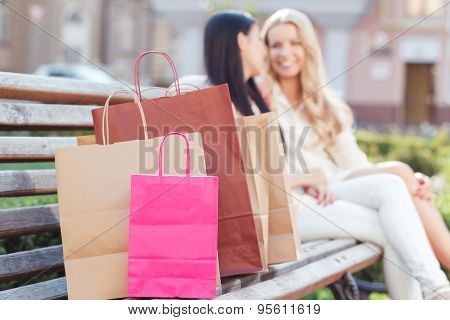Two friends on the walk after shopping