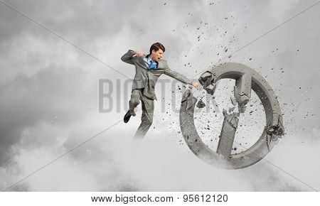 Angry determined businessman crashing stone prohibition symbol