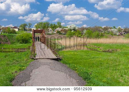Landscape in Ukrainian country with small foot-bridge