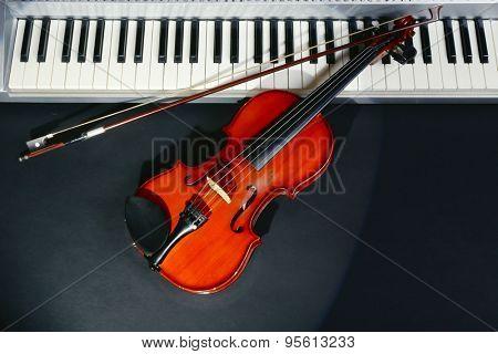 Violin and piano on dark background