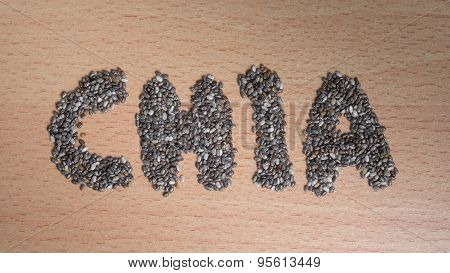 Chia Word Made From Chia Seeds On Wooden Plate
