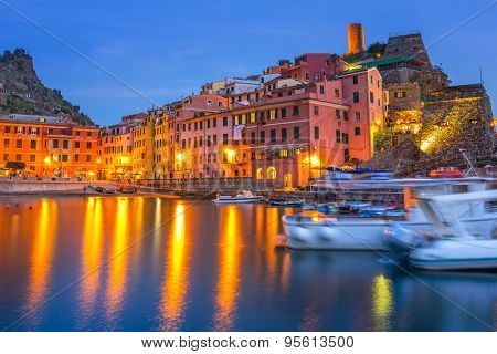 Vernazza town on the coast of Ligurian Sea at dusk, Italy
