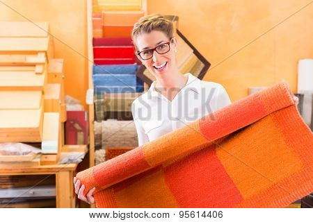 Interior Designer buying rug or carpeting in home improvement store