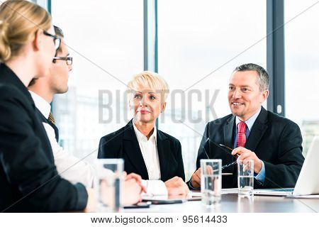Business - meeting in office, the businesspeople or lawyers in team are discussing a document on Laptop computer