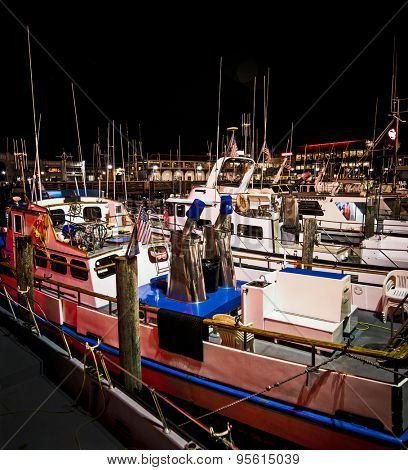 Small fishing boats moored at Fisherman's Wharf in San Francisco