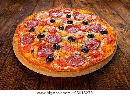 Delicious Pizza With Salami, Mushrooms And Olives