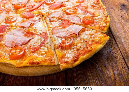 Delicious Pizza With Bacon And Cherry Tomato