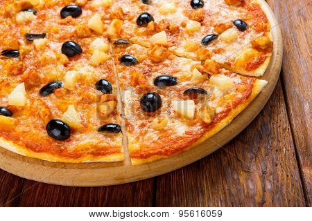 Delicious Pizza With Pineapple, Chicken And Olives