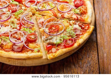 Delicious Pizza With Onions, Bacon And Cherry Tomato