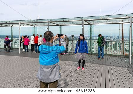 Tourists Making Pictures From Montparnasse Tower In Paris, France