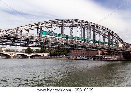 Bridge Over River Seine In Paris With Subway Passing