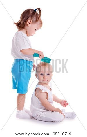 Children Playing With Comb. Two Little Girls Isolated On White Background.