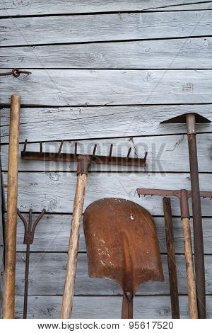 The Old Rusty Tradition Tools, Instruments, Implements And Farm Or Household Equipment On Wooden She