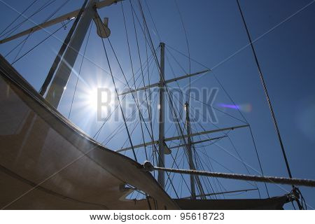 Looking up at sails and mast of boat yachting