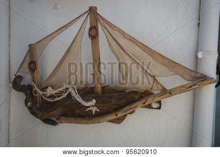 Wooden Model Of  Sailing Boat On The Wall, Milos, Greece