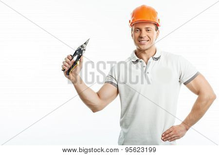 Handsome young worker with hardhat and equipment
