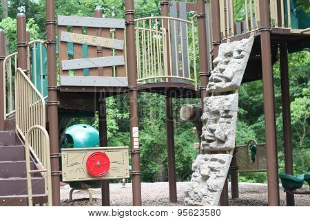 Kids playground with rock wall