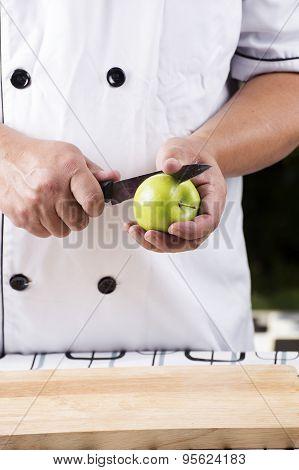 Chef Cutting Green Apple