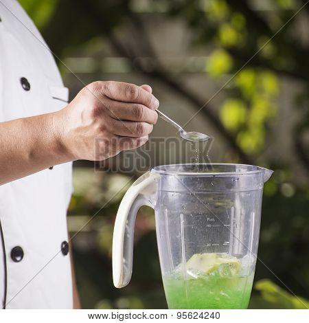 Putting Salt For Making Green Apple Smoothie