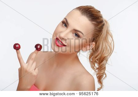Beautiful young woman with sweet red bird-cherry
