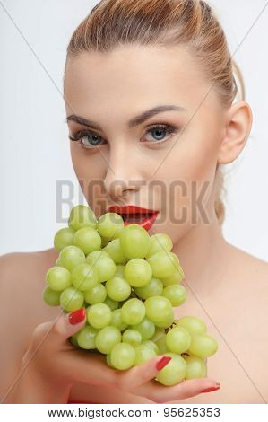 Cheerful young girl with fresh green fruit
