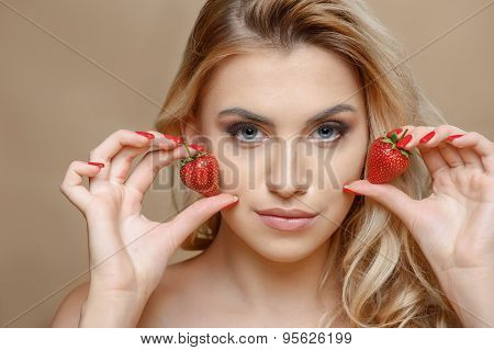 Attractive young woman with red sweet berry