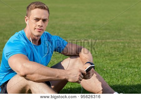 Attractive young athlete is relaxing after running