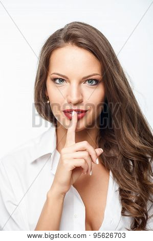 Cheerful young woman is asking for silence