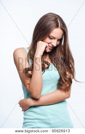 Attractive young woman is expressing her shyness