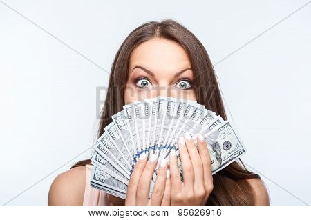 Cheerful young girl with a big amount of dollars