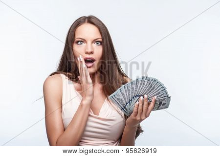 Beautiful young woman is very rich and shocked
