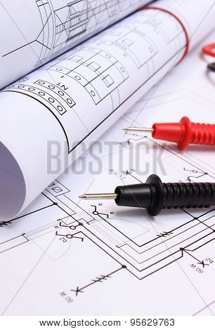 Rolls Of Electrical Diagrams And Cables Of Multimeter On Drawing Of House