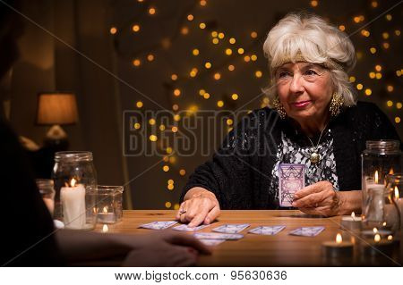 Elder Female Telling Someones Fortune