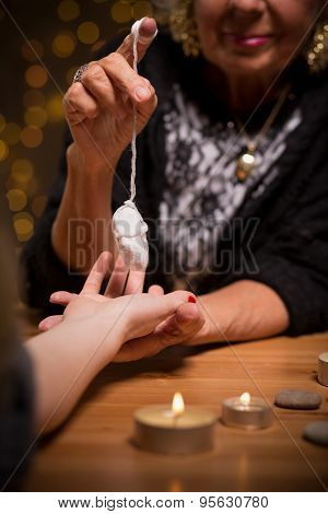 Female Fortune Teller Using Pendulum