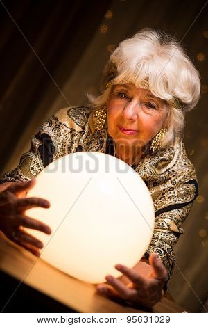 Seer Holding Crystal Ball