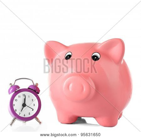 Piggy bank with alarm clock isolated on white