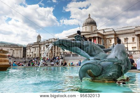 LONDON - JUNE 24: National Gallery on Trafalgar square on June 24 2015 in London, UK. The fountain in the centre of the square is a popular place for tourist to rest during sightseeing.