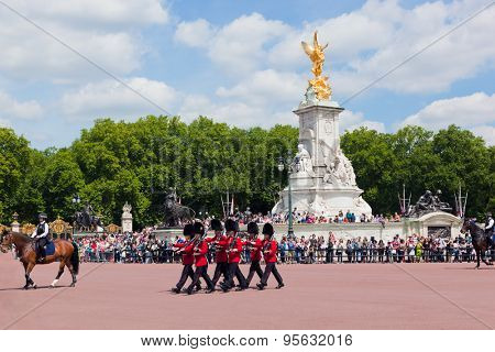 LONDON - JUNE 24: British Royal guards perform the Changing of the Guard in Buckingham Palace on June 24, 2015 in London, UK. Queen's Guard change is one of the major tourist attraction in England