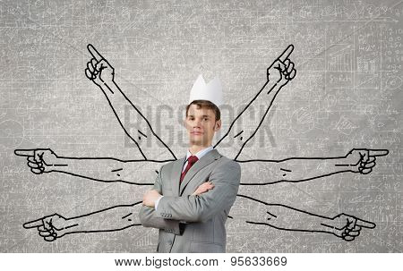 Young man with many drawn hands behind back