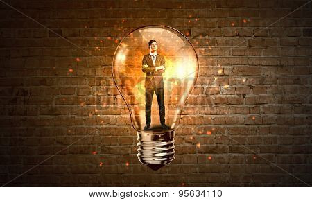 Man holding luminous idea inside light bulb