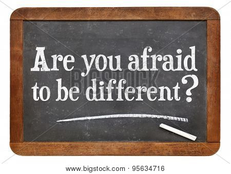 Are you afraid to be different question on a vintage slate blackboard