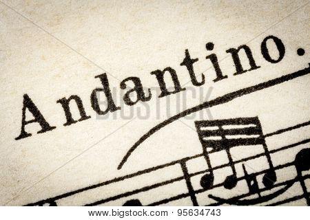 Andantino  -  slow, walking music tempo - macro detail from vintage sheet music