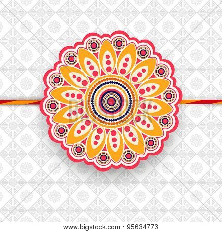 Beautiful floral design decorated rakhi on stylish background for Indian festival, Happy Raksha Bandhan celebration.