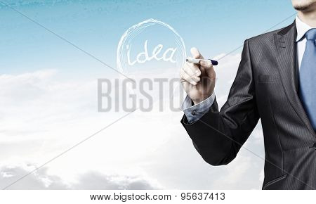 Close up of businessman drawing idea light bulb