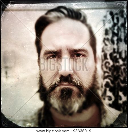 Instagram filtered vintage style portrait of a man with a beard