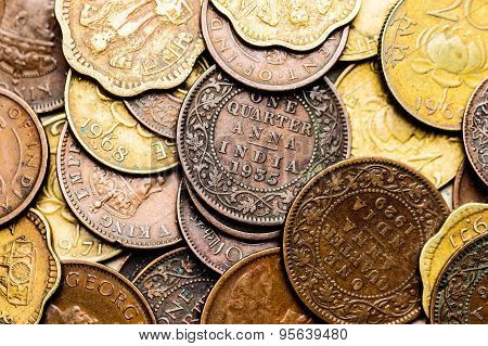 Macro view of antique Indian coins which are no longer in circulation