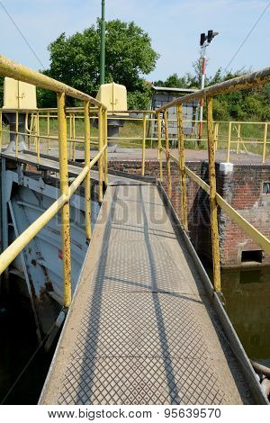 Footbridge On Top Of Sluice Gate.