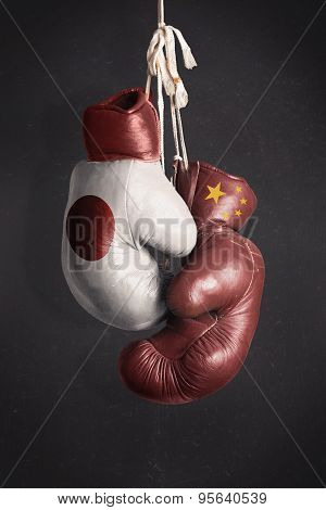 Partnership Economic Power Between The China And Japan Symbolized With Boxing Gloves