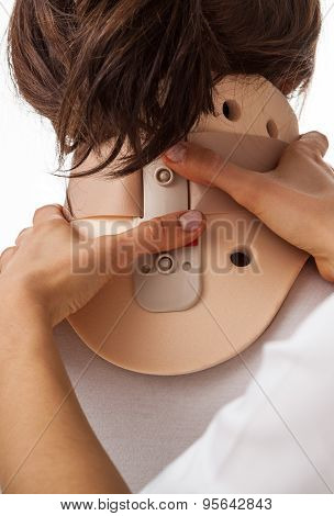 Woman Using Cervical Collar